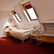 Slaapkamer boven met zonnebank – Weidevilla – Boerkerij Hollum Ameland